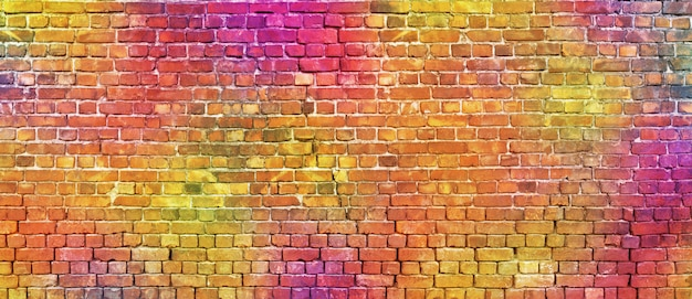 Painted brick wall, abstract background of different colors Premium Photo