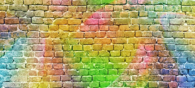 Painted brick wall, abstract background a diverse color Premium Photo