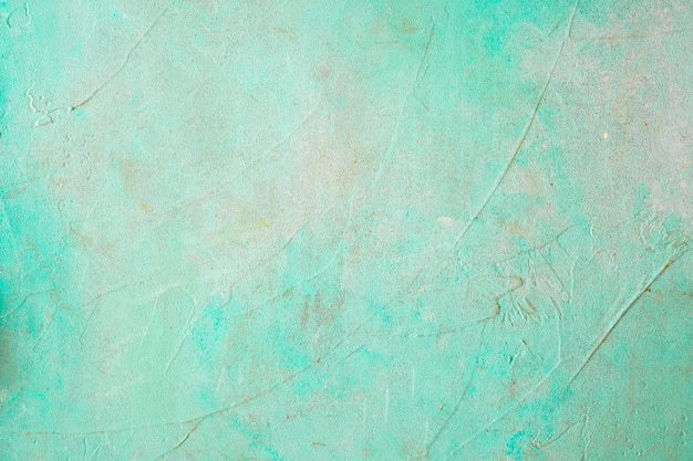 Painted concrete weathered turquoise wall Free Photo