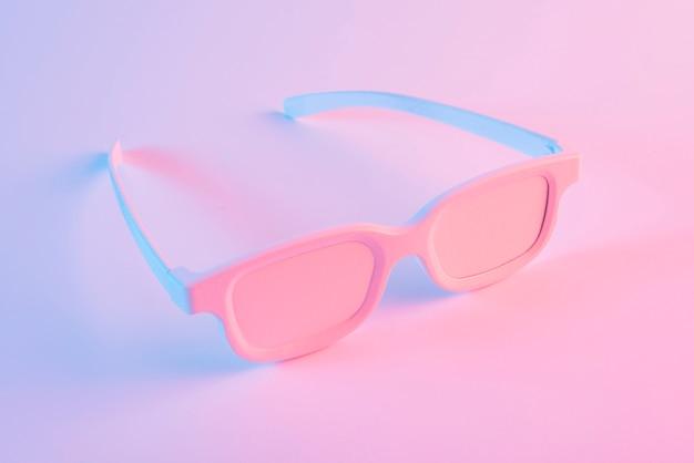 Painted eyeglasses against pink background Free Photo