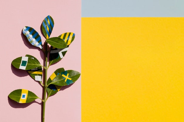 Painted ficus with yellow copy space background Free Photo