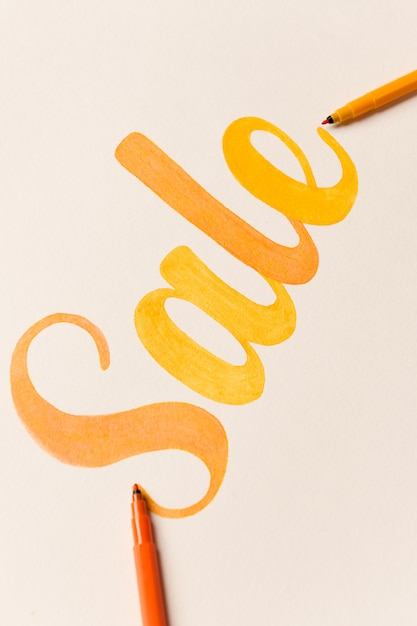 Painted lettering sale on white background Free Photo