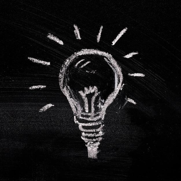 Painted light bulb on black background Free Photo