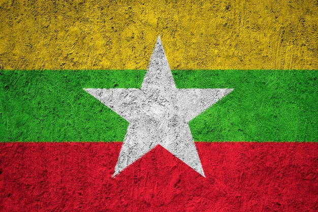 Painted national flag of burma / myanmar on a concrete wall Premium Photo