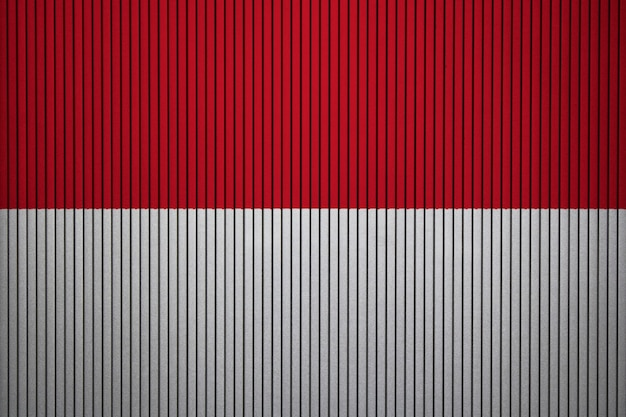 Painted national flag of indonesia on a concrete wall Premium Photo