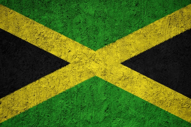 Painted national flag of jamaica on a concrete wall Premium Photo