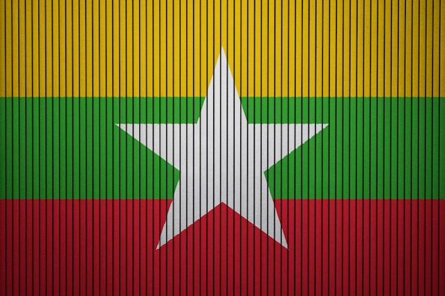 Painted national flag of myanmar on a concrete wall Premium Photo