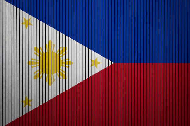 Painted national flag of philippines on a concrete wall Premium Photo