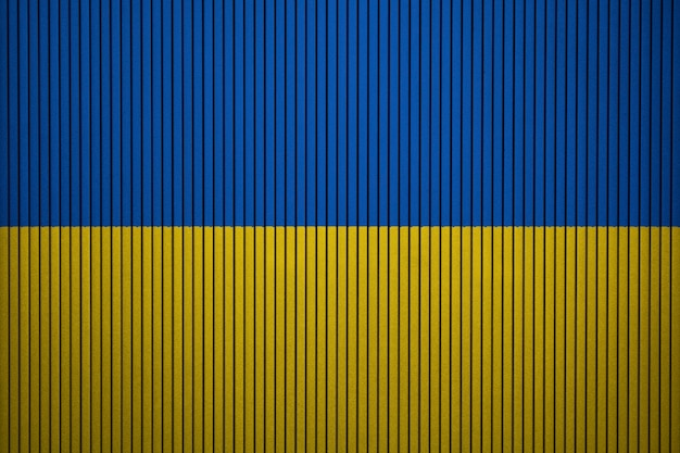 Painted national flag of ukraine on a concrete wall Premium Photo