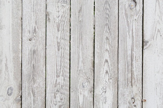 Painted old tacky grey wooden fence Premium Photo