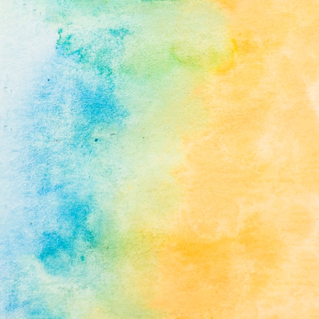 Painted textured paper with blue and yellow water color background Free Photo