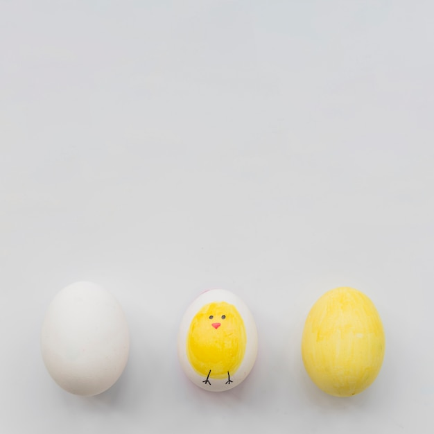 Painted three eggs on white background Free Photo