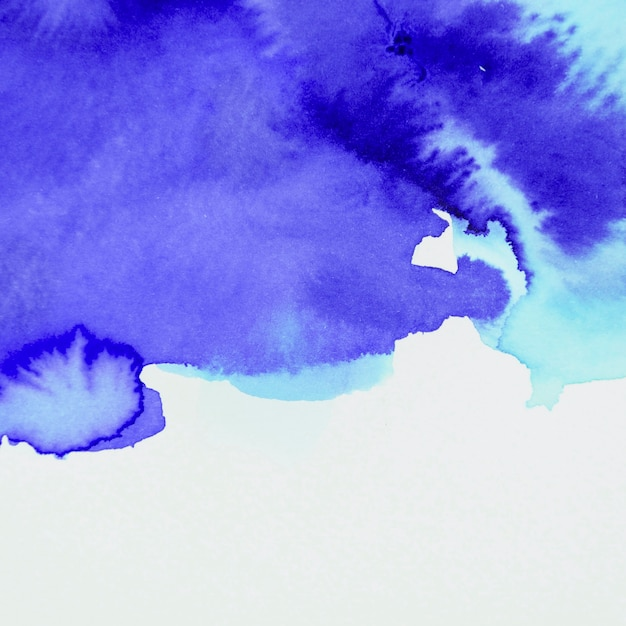 Painted watercolor smooth blue backdrop on white backdrop Free Photo