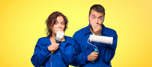 Painters covering mouth for saying something inappropriate. Premium Photo