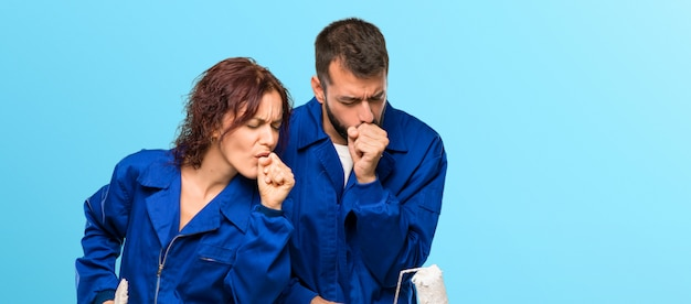 Painters suffering with cough and feeling bad on colorful background Premium Photo