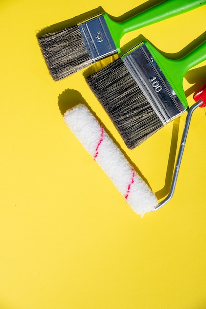 Painting tools. brushes and roller.paint roller and brush in the accessories for home renovation Premium Photo