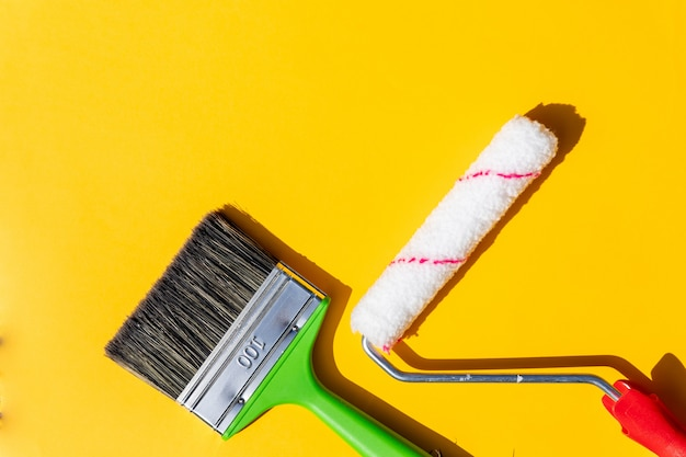 Painting tools. brushes and roller.painting supplies paint roller and brush in the accessories for home renovation Premium Photo