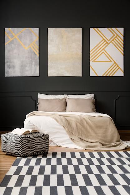 Paintings on black wall in bedroom Premium Photo