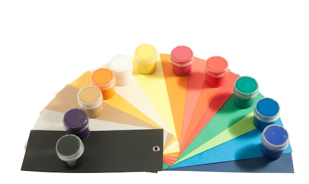 Paints and colored paper Free Photo
