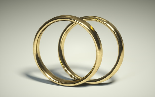 Pair of a 3d golden wedding ring. alliances. relationship rings on a white background Premium Photo
