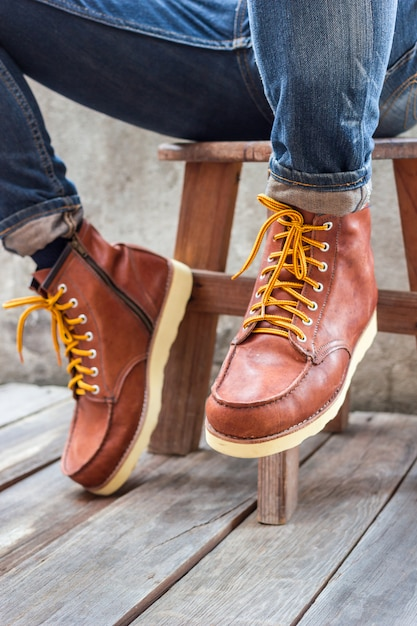 A pair of brown leather boots Free Photo