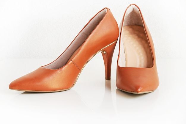 Pair of classic women brown leather heels. fashion footwear. isolated Premium Photo