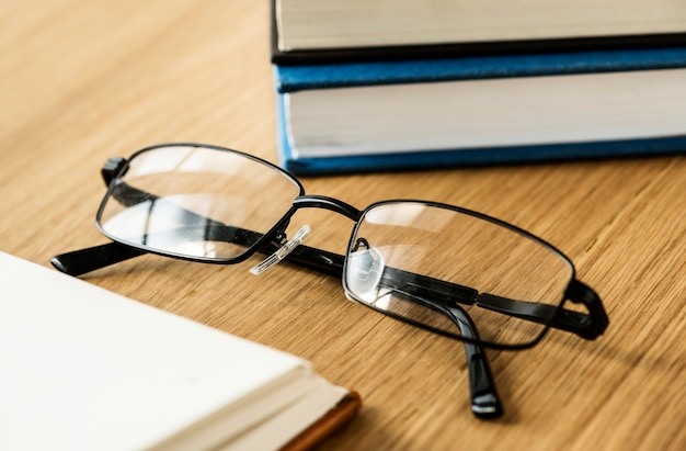 A pair of glasses and books educational, academic and literary concept Free Photo