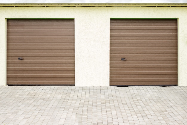 Pair of modern garage doors. large automatic up and over garage doors for a wealthy holiday home. Premium Photo