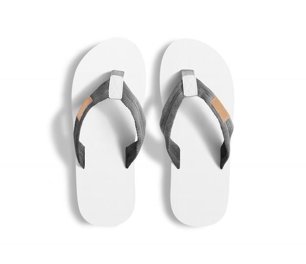 空白の白いスリッパ、デザインモックアップのペア。 Premium写真