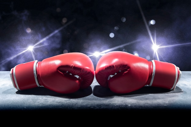 Pair of red boxing gloves on the table Premium Photo