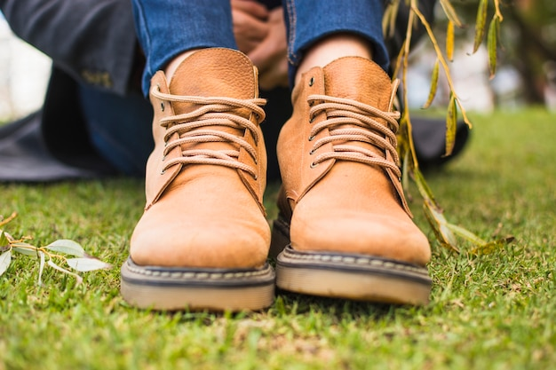 Pair of shoes on autumn grass Free Photo