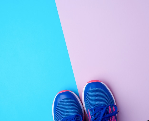 Pair of sports sneakers with blue laces Premium Photo