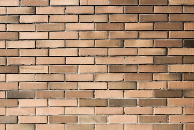 Pale brown wall bricks background texture Free Photo