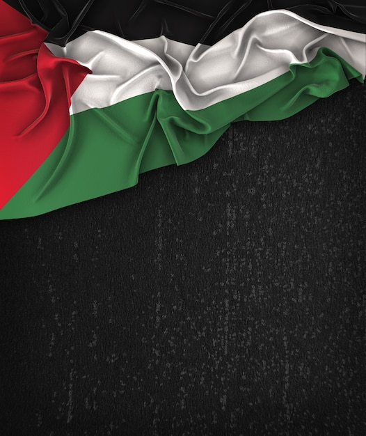 palestine flag vintage on a grunge black chalkboard with space for