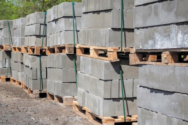 Pallets of cinder blocks on a construction site