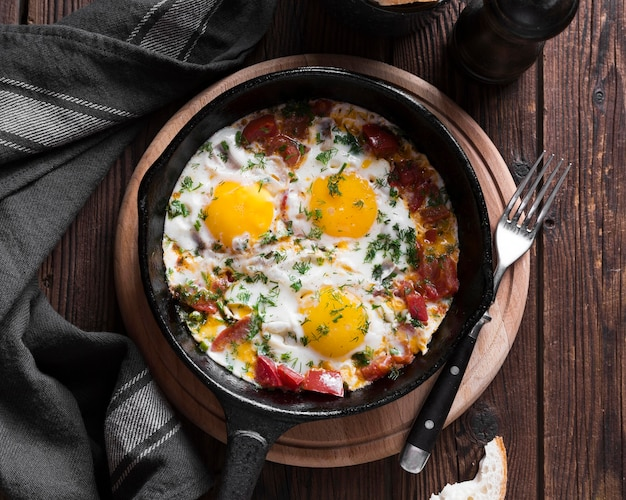 Pan with fried eggs Free Photo