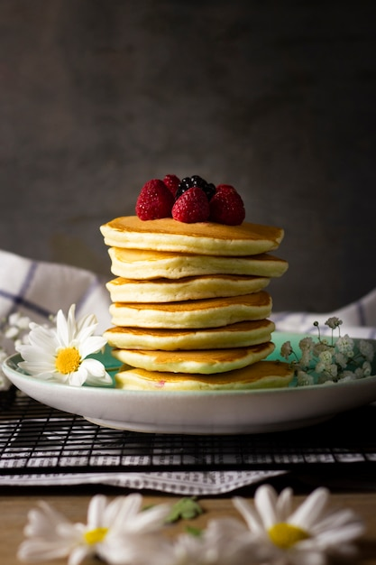 Pancake tower with forest fruits Free Photo