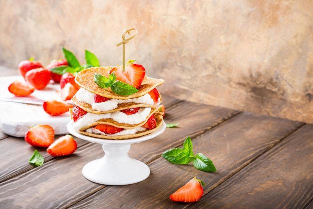 Pancakes cake with yogurt and strawberries Premium Photo