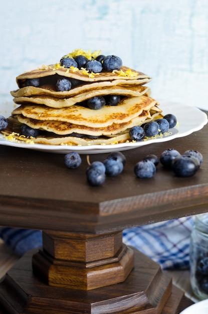 Pancakes with blueberry on white plate. Premium Photo
