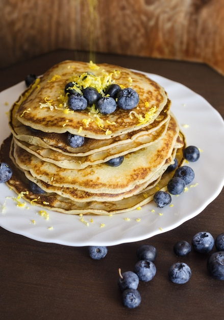 Pancakes with blueberry on white plate. Premium Photo