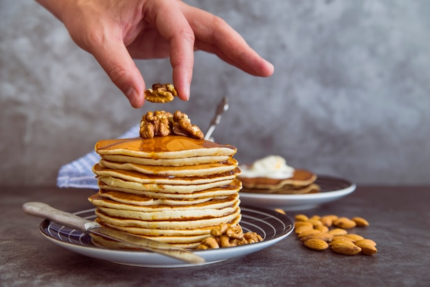 Pancakes with walnuts on top Free Photo