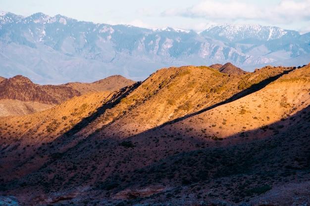Panorama of a beautiful landscape with mountain ranges at sunset. kazakhstan Premium Photo