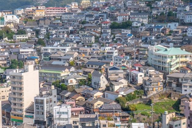 Panorama view of nagasaki city with montain and  blue sky background, cityscape, nagasaki, kyushu, japan Premium Photo
