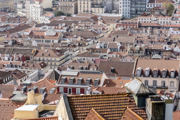 Panoramic aerial image of a lisbon town with red shingles covered roofs Free Photo