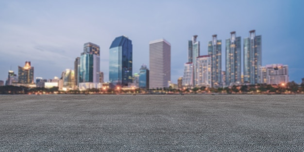 Panoramic empty concrete floor and skyline with buildings Premium Photo