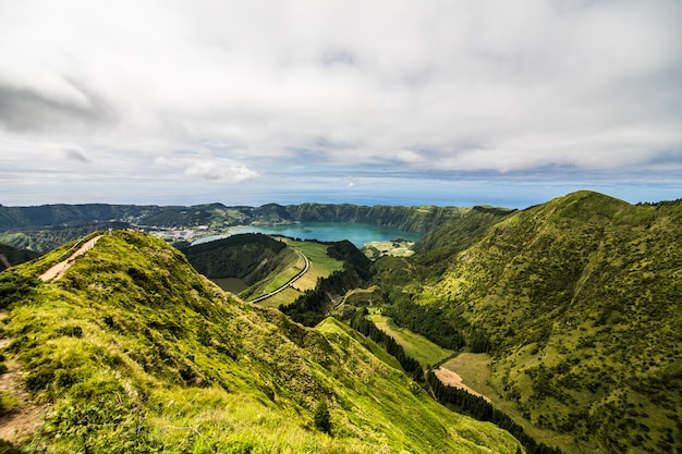 Panoramic landscape overlooking three amazing ponds, lagoa de santiago, rasa and lagoa azul, lagoa seven cities. the azores are one of the main tourist destinations in portugal Free Photo