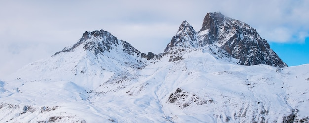 Panoramic shot of beautiful rocky mountains covered with snow in france Free Photo