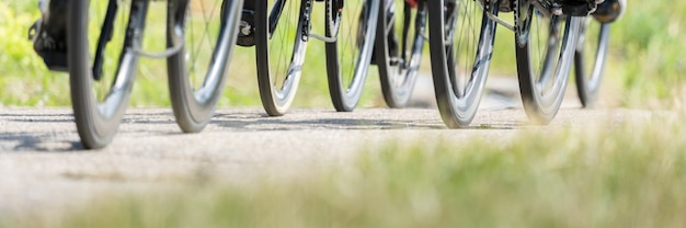 Panoramic shot of  bicycle wheels riding on a ground Free Photo