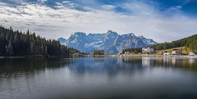 Panoramic shot of the lake lago di misurina with reflections in the italian alps Free Photo