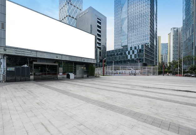 Panoramic skyline and buildings with empty concrete square floor in shenzhen, china Premium Photo